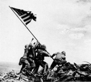 Flag raising on Iwo Jima. Hayes is on the far left.