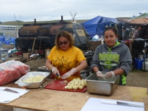 The camp has many volunteers, including those who help prepare the food.