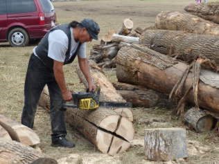There is a constant buzz of chainsaws as volunteers keep the camp stocked with firewood.