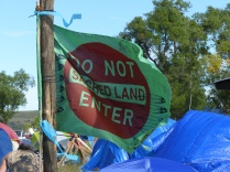 The camp is filled with signs and flags, large and small