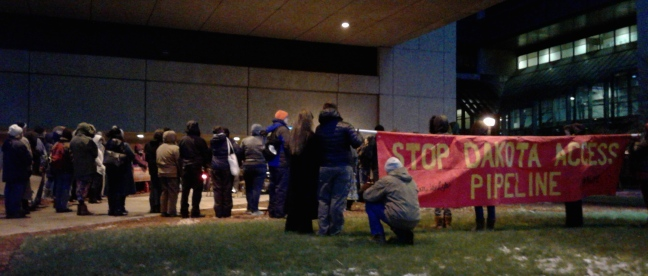 Vigil outside of HCMC Tuesday night for Sophia Wilansky, a 21-year-old water protector injured by a concussion grenade.