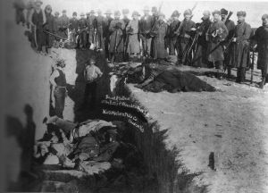 Burial of the dead in a mass grave after the massacre of Wounded Knee. (Wikimedia Commons)