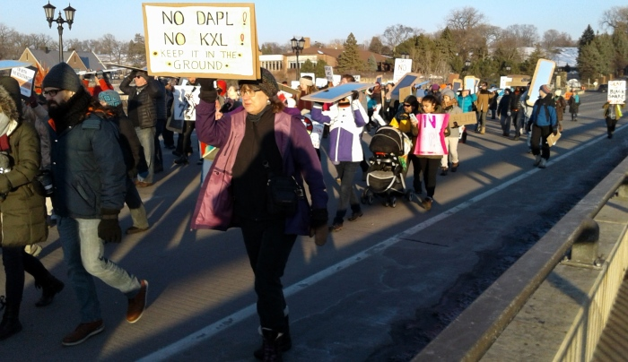 The St. Paul side of the march heads to the center of Marshal Avenue bridge.